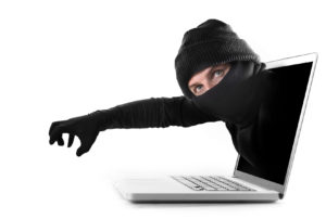 anonymous hacker and cyber criminal man coming out from computer laptop screen with grabbing and stealing hand in black glove as conceptual password hacking and cyber crime